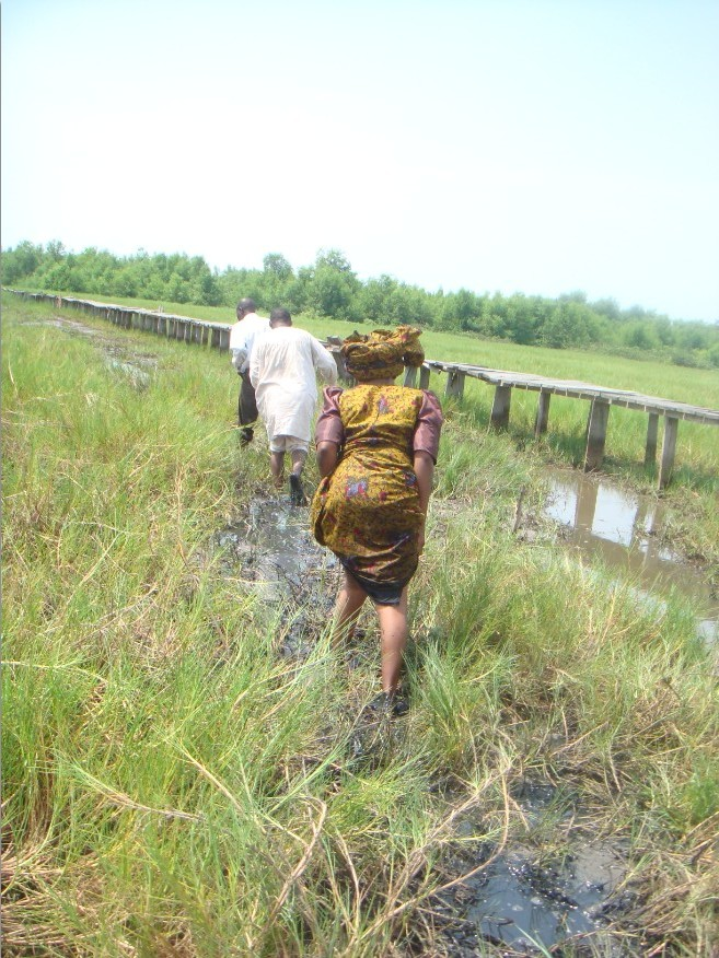 Mrs Oluwalowo and a church member decided not to take the warf after it's near collapse